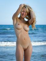 Beautiful Blonde Nudist Girl at the Beach