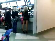 Girl with a too Short Skirt Filmed in Public Place