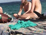 Voyeur hidden camera filming topless girls at the beach