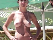 Young Romanian girl with nice tits filmed topless at the beach