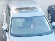 Romanian woman caught performing a blowjob in car