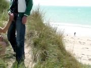 Public handjob with cumshot at the beach hidden in the bushes