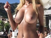 Rich topless blonde filmed at private pool